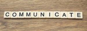 communicate-word-written-tiles-wooden-surface-45536766